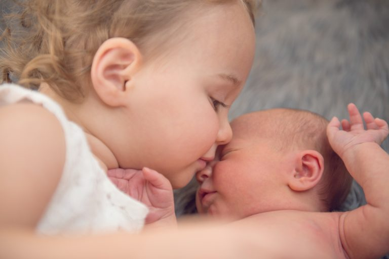Newborn baby and sibling