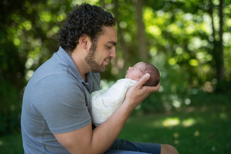 Newborn baby and father
